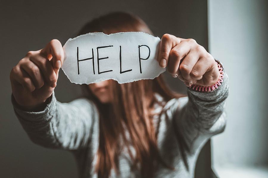 girl-holding-help-sign.jpg